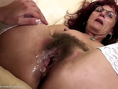 Deep fisting for sexy mature mom's furry pussy