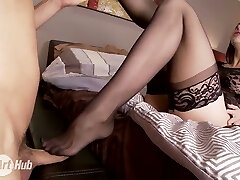 Lengthy legged dark haired beautiful sexpot in stockings gets pussy gobbled