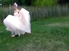 Hard Bride having fun outdoor. Public submission BDSM