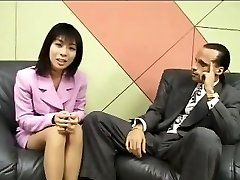 Miniature Japanese reporter swallows cum for an interview