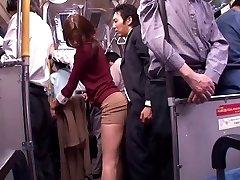 Japanese whore sucks penis in a public bus