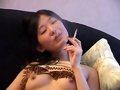 Asian Smoking Stripped on Bed