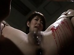 Pouring wax on her wet pussy and this babe loves the bdsm stuff