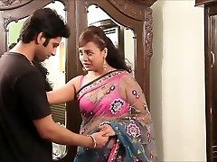 Indian teacher in handsome pinkish bra and sari seducing young guy