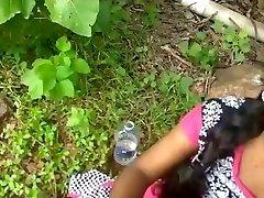 College girl plowing outdoor with her teacher