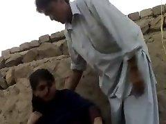 muslin teen with guy in feild