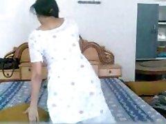 Punjabi Stunner unclothes and masturbates while on phone