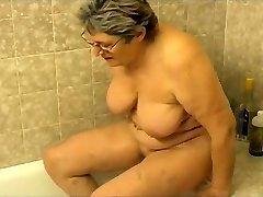 Grannie masturbating in the bathroom
