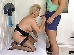 Mature plumper is getting a massage and a exercise with a hard wood