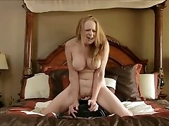 Big-boobed mature cums on the sybian saddle