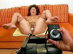 Fat milf chick is testing a new sex machine with her legs spread wide open