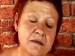 Red-haired grandma fucked by the machine