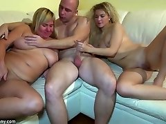 Youthful girl fucking in three-way with granny