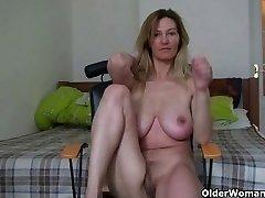 MILF with big boobs rubs her mature vulva