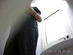 Russian grandma pissing in public toilet