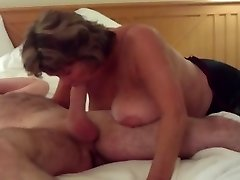 Busty Mature Guzzles All of Big Young Man Meat