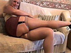 Mature ash-blonde with great body in tight mini skirt