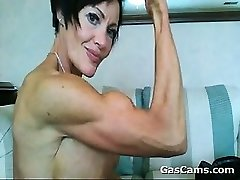 Muscled Mature Dame Flexing