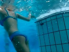 swimsuits underwater at pool