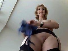 Mature English ash-blonde babe in stockings upskirt tease