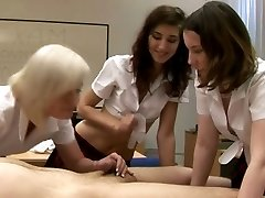 CFNM schoolgirls anxious to tug man meat in their class room