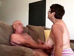 Wife giving husband a blow mitt job