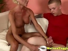 Masturbating granny gets some cream from a midget