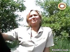 Mature blonde mega-bitch pisses outside part2