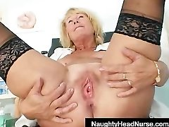 Blonde milf Greta big natural milk sacks and uniform