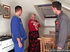 2 repairmen fuck chesty grandma from both ends