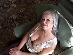 Infatuating busty grandma striptease