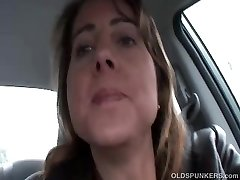 Sexy MILF is so horny she plays with her gash in public