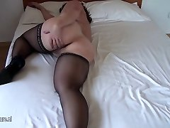 Chesty amateur elderly mom getting wet on her bed