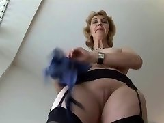 Mature English blonde honey in stockings upskirt tease