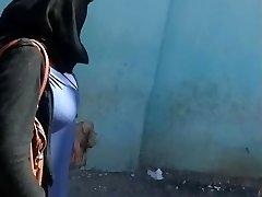 Arab mummy with massive boobs walk in street