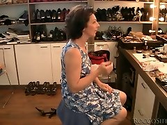 Brown-haired grandmother is poked upskirt from behind in POV