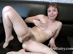 Trixie unclothes and jerks on her black couch