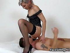 Hot stockings legs mom Beate sitting on a boy