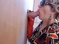Milf in boots watches porno and enjoys gloryhole oral