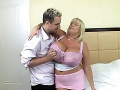 Blonde mature with hefty silecone tits