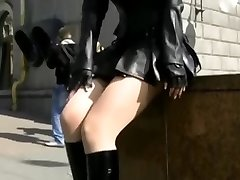 Super-steamy goth Cougar in black leather miniskirt upskirt ass revealed in the streets