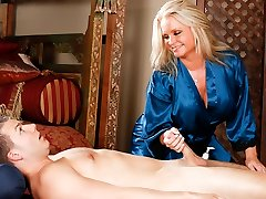 Maya Devine massaging a much junior guy