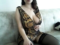 Good-sized boobs mature lady in slip and stockings