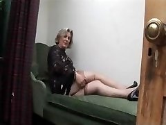 Big-boobed granny in stockings shows off plump cameltoe and furry pussy