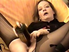 Amateur - horny Mature twin bottles her cunt & Culo