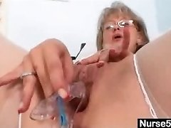 Mature Nurse luving the office alone