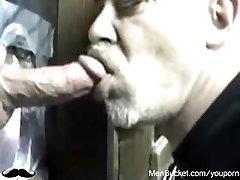 Mature amateur studs eating dicks from gloryholes