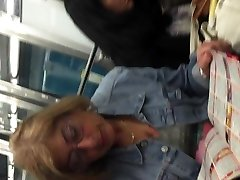 Platinum-blonde mature upskirt in metro with face