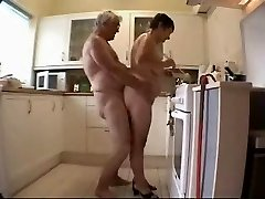 Old couple having joy in the kitchen