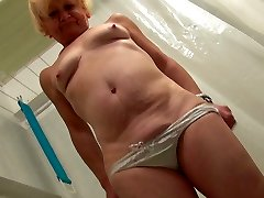 Ugly scaring blonde oldie takes a shower and teases her mature cunt